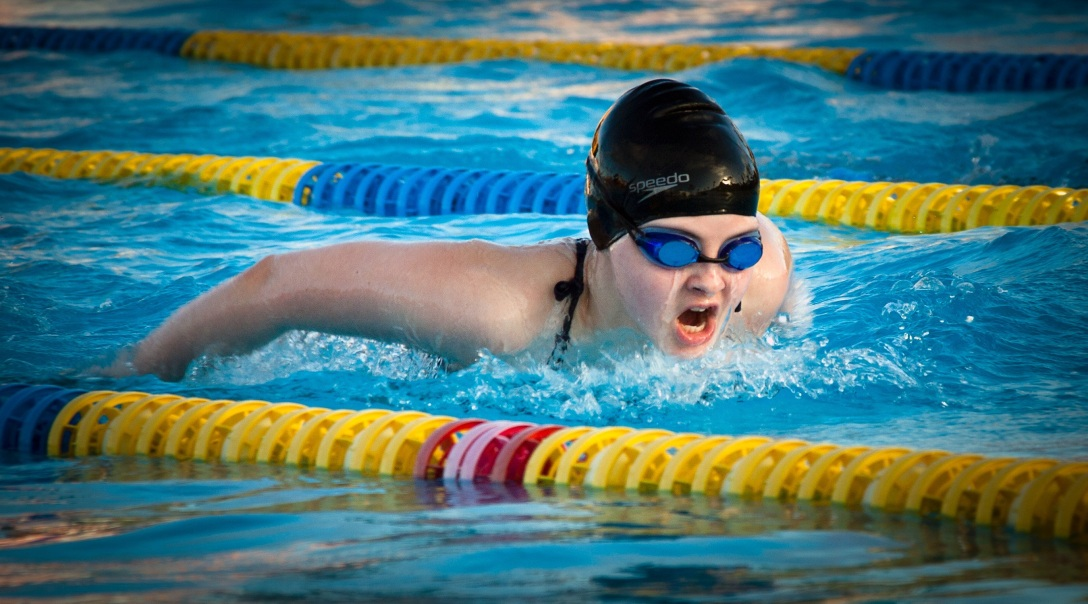 swimmer swims laps in pool